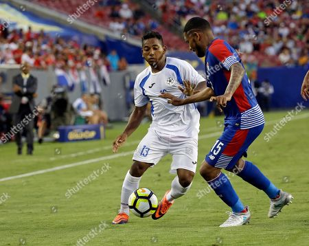 Nicaragua's Bryan García (13) tries to get past Panama's Erick Davis (15) during a CONCACAF Gold Cup soccer match, in Tampa, Fla. Panama won 2-1