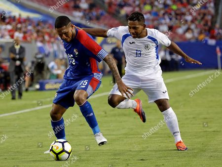 Nicaragua's Bryan García (13) tries to get around Panama's Erick Davis (15) to steal the ball during a CONCACAF Gold Cup soccer match, in Tampa, Fla. Panama won 2-1