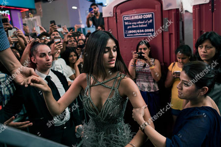 Disha Patani is held as she makes her way to the stage during The 18th edition of the International Indian Film Academy (IIFA) awards weekend event at Times Square, in New York
