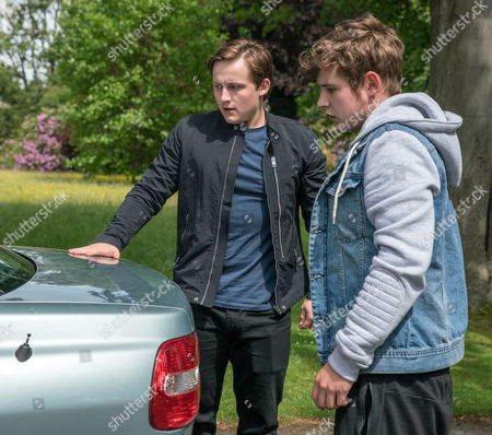 Lachlan White, as played by Thomas Atkinson and Gerry, as played by Shaun Thomas, intercept Tim, as played by Mark Moraghan, who is heading over to see Chrissie and together bundle him into the car boot and kidnap him. Tim tries to explain himself but Lachlan threatens him. (Ep 7893 - Mon 31 Jul 2017)