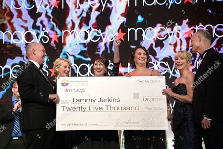 Tammy Jerkins, Dennis Witte, Pam Stewart, Lee O'Rourke, Ann Scott, Rick Scott Tammy Jerkins, center, Secondary Mathematics teacher from Leesburg High School in Lake County, holds her $25,000 check from Macy's and the Florida Department of Education after being named the 2018 Macy's/Florida Department of Education Teacher of the Year, in Orlando, Fla. She is joined by Dennis Witte, left, Executive Vice President and Regional Director of Stores for Macy's, Pam Stewart, second from left, Florida Commissioner of Education, Lee O'Rourke, third from right, District Vice President of Northern Florida for Macy's Florida, First Lady Ann Scott, and Florida Governor Rick Scott, right