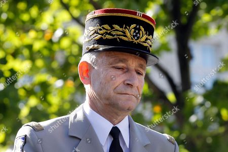 French Army Chief of Staff, General Pierre de Villiers, arrives to attend the annual Bastille Day military parade on the Champs Elysees avenue in Paris, France