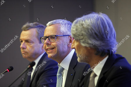 Altice Group CEO Michel Combes (C) accompanied by Altice Media CEO Alain Weill (L) and Portugal Telecom Chairman and CEO Paulo Neves (R) attend a press conference on the purchase of Altice on the Media Capital group at the Altis Hotel in Lisbon, Portugal, 14 July 2017. The Altice Group has reached an agreement with Prisa to acquire Portuguese media company Media Capital SGPS, SA, which owns television station TVI, the company said on Friday.