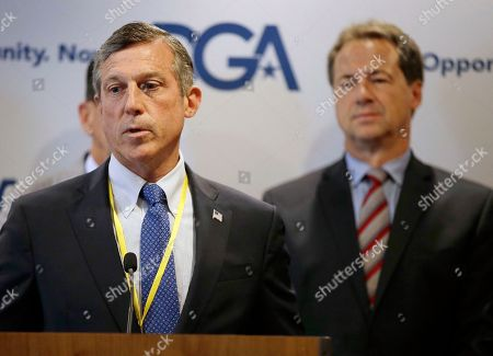 Roy Cooper, Steve Bullock Delaware Democratic Gov. John Carney addresses a Democratic Governors joint news conference during the National Governor's Association meeting to highlight the damaging impact they contend the pending Senate health care bill would have on their states at the second day of the NGA meeting, in Providence, R.I. Montana Gov. Steve Bullock looks on