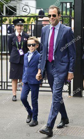 Greg Rusedski with his son John James Rusedski arrives on day 13