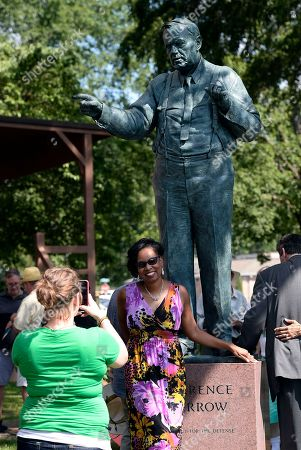 Jennifer Taylor has her photograph taken with the Clarence Darrow statue after the dedication ceremony in front of the Rhea County Courthouse, in Dayton, Tenn. Darrow was the lawyer who defended John T. Scopes, a biology teacher, who fought Tennessee's law banning the teaching of evolution