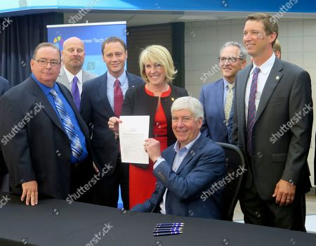 Rich Snyder Michigan Gov. Rick Snyder smiles after signing a $56.5 billion state budget, at the Kent Intermediate School District Career Tech Center in Grand Rapids, Mich. Looking on from left are: state Superintendent Brian Whiston; budget director Al Pscholka; House Speaker Tom Leonard; House Appropriations Chairwoman Laura Cox; Rep. Chris Afendoulis; and Senate Appropriations Chairman Dave Hildenbrand