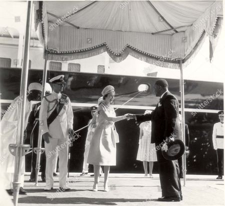 Editorial picture of African Tour - Sierra Leone December 1961 Royal Visit To Sierra Leone - Lp3d The Queen Shaking Hands With The Speak Of The House Of Parliament The Hon. Mr Justice N.j. Lightfoot Boston At The Queen Elizabeth Ii Quay On Their Arrival. Sir Milton Malga