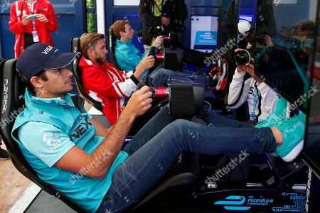Left to right) Formula E drivers Nelson Piquet Jr., Oliver Turvey, and Nick Heidfeld compete in the eRace qualifying session at the Visa Everywhere Lounge at the Formula E Race, in the Brooklyn borough of New York