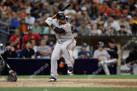 San Francisco Giants' Miguel Gomez bats during the sixth inning of a baseball game against the San Diego Padres, in San Diego