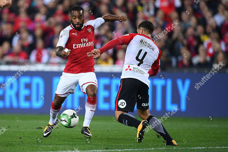 Alexandre Lacazette (L) of Arsenal in action with Josh Risdon of the Wanderers during the friendly soccer match between the Western Sydney Wanderers and Arsenal FC at ANZ Stadium in Sydney, Australia, 15 July 2017.