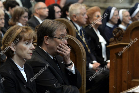 Mayor of Cologne Henriette Reker (L) and Premier of North Rhine-Westphalia, Armin Laschet (2-L), during the funeral service for late Cardinal Joachim Meisner at Cologne Cathedral in Cologne, Germany, 15 July 2017. Meisner died in his sleep on 05 July 2017 while on holiday in the southern German town of Bad Fuessing, a spokesman for the Cologne archdiocese said. He was considered to be one of the most influential figures from the conservative wing of Germany's Catholic Church.