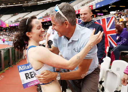 Stef Reid of Great Britain celebrates winning gold in the Womens Long Jump T44 with family and friends.