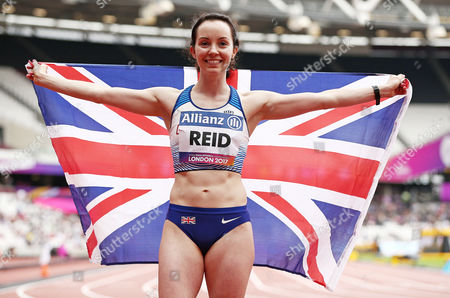 Stef Reid of Great Britain celebrates winning gold in the Womens Long Jump T44.