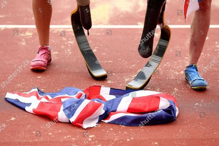 A close up of a British flag at the feet of Stef Reid of Great Britain after winning gold and silver medalist Marlene van Gansewinkel of The Netherlands.