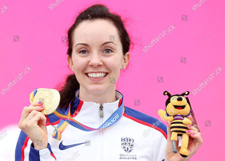 Stef Reid of Great Britain poses with her gold medal won in the Womens Long Jump T44.