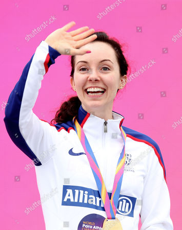 Stef Reid of Great Britain waves with her gold medal won in the Womens Long Jump T44.