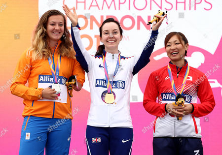 Stef Reid of Great Britain waves to the crowd after winning gold in the Womens Long Jump T44 with silver medalist Marlene van Gansewinkel of The Netherlands and Bronze medalist Maya Nakanishi of Japan.