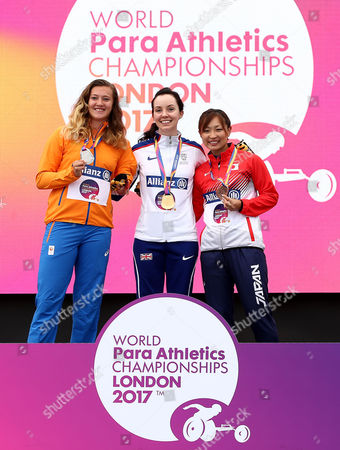 Stef Reid of Great Britain poses after winning gold in the Womens Long Jump T44 with silver medalist Marlene van Gansewinkel of The Netherlands and Bronze medalist Maya Nakanishi of Japan.