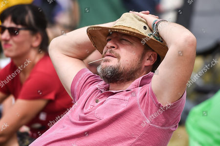 A man relaxes in the sunshine while watching Lucy Rose