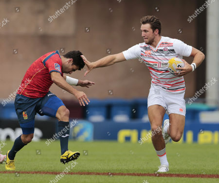 Stock Picture of Harry Glover hands off Francisco de Paula Hernandez Jimenez during the Spain v England match at the Mitsubishi Motors Exeter 7s at Sandy Park, Exeter, Devon on 15 July.