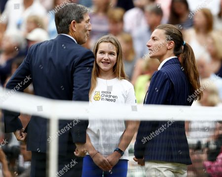Stock Image of Twelve-year-old Rebecca Jones (C) arrives for the coin toss ceremony on Centre Court prior to the Women's final match Garbine Muguruza of Spain against Venus Williams of the USA for the Wimbledon Championships at the All England Lawn Tennis Club, in London, Britain, 15 July 2017.