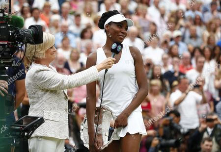 Venus Williams of the US is interviewed by Sue Barker following her defeat by Garbine Muguruza of Spain in the women's final of the Wimbledon Championships at the All England Lawn Tennis Club, in London, Britain, 15 July 2017.