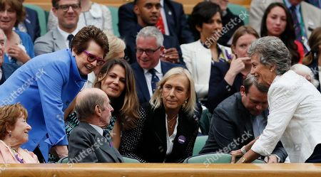 Tennis legends Billie Jean King, left, Martina Navratilova, center, and Virginia Wade, right, speak with the Duke of Kent, front second left, before the Women's Singles final match between Venus Williams of the United States and Spain's Garbine Muguruza on day twelve at the Wimbledon Tennis Championships in London