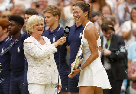 Garbine Muguruza of Spain celebrates winning the Ladies Final as she is interviewed by Sue Barker