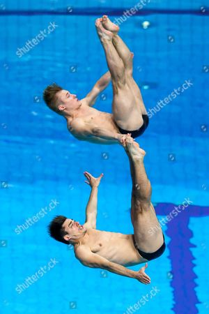 Chris Mears and Jack Laugher of Great Britain compete in the Mens 3m Synchronised Springboard Preliminary.