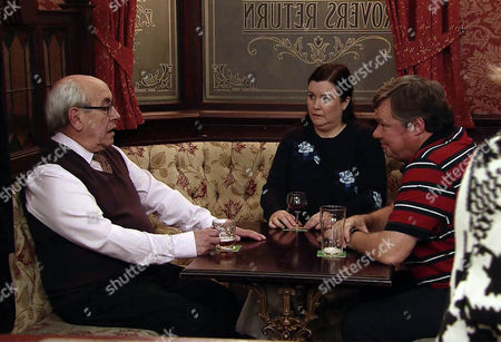 Stock Photo of Mary Taylor, as played by Patti Clare, tries to enjoy her drink but the atmosphere is strained with Norris Cole, as played by Malcolm Hebden, and Brendan, as played by Ted Robbins, sniping at each other. (Ep 8825 - Mon 25th Jan 2016).