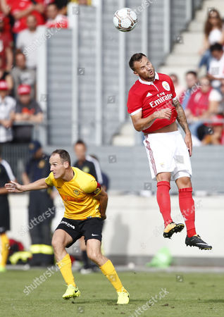 Stock Image of Benfica's Haris Seferovic, right, against Young Boys' Steven von Bergen during a friendly soccer match of the international Uhrencup tournament between Switzerland's BSC Young Boys and Portugal's Benfica Lisbon at the Tissot Arena in Biel, Switzerland, Saturday, July 15, 2017.
