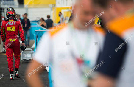 Daniel Abt, center, of ABT Scahaeffler Audi Sport walks to the pits after leaving his car which stopped on the track during the New York City Eprix Formula E New York City ePrix all-electric auto race, in the Brooklyn borough of New York