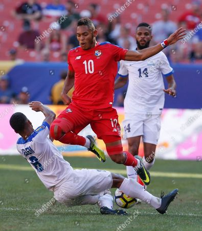 Jordy Delem, Ismael Diaz Martinique's Jordy Delem (8) makes a slide-tackle against Panama's Ismael Diaz (10) during a CONCACAF Gold Cup soccer match in Cleveland, Ohio