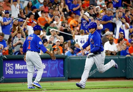 Anthony Rizzo, Gary Jones Chicago Cubs' Anthony Rizzo, right, rounds the bases past third base coach Gary Jones after hitting a solo home run in the eighth inning of a baseball game against the Baltimore Orioles in Baltimore