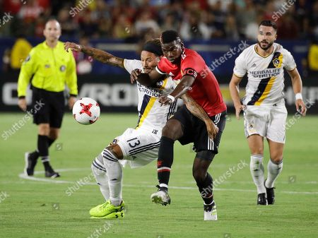 Paul Pogba, Jermaine Jones Manchester United's Paul Pogba, front right, and Los Angeles Galaxy's Jermaine Jones vie for the ball during the second half of a friendly soccer match, in Carson, Calif. Manchester United won 5-2