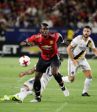 Paul Pogba, Jermaine Jones Manchester United's Paul Pogba dribbles the ball past Los Angeles Galaxy's Jermaine Jones during the second half of a friendly soccer match, in Carson, Calif. The Manchester United won 5-2