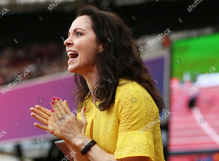 Stef Reid of Great Britain who won a gold in the Womens Long Jump yesterday watches on as husband Brent Lakatos of Canada wins gold in the Mens 200m T53.