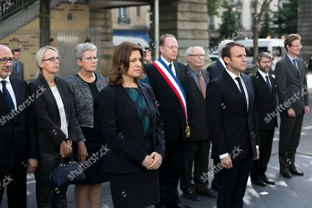 Israeli Ambassador Aliza Bin-Noun, left, and French President Emmanuel Macron, center right, pay their respect after laying a wreath at the Vel d'Hiv roundup memorial, during a ceremony commemorating the 75nd anniversary of the Vel d'Hiv roundup, in Paris. French Jewish leaders are giving speeches at an emotional ceremony at the Vel d'Hiv stadium outside Paris, where French police rounded up some 13,000 people on July 16-17, 1942 before they were sent on to camps. Fewer than 100 survived