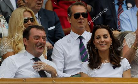 Kate, the Duchess of Cambridge next to Philip Brook, Chairman of the All England Lawn Tennis Club, and in front of former Swedish tennis player Stefan Edberg in the Royal Box ahead of the Men's Singles final match between Switzerland's Roger Federer and Croatia's Marin Cilic on day thirteen at the Wimbledon Tennis Championships in London