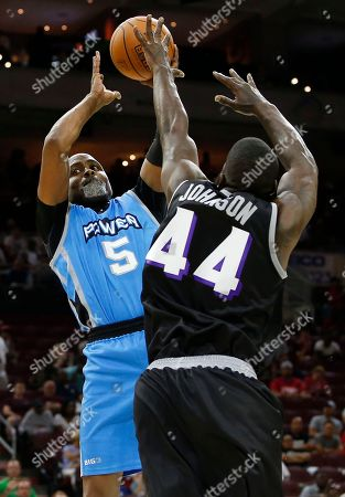 Stock Image of Cuttino Mobley, Ivan Johnson The Power's Cuttino Mobley (5) has his shot blocked by Ghost Ballers Ivan Johnson (44) during the first half of Game 1 in the BIG3 Basketball basketball League in Philadelphia, Pa