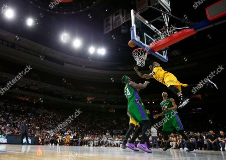 Stock Image of Stephen Jackson, Kwame Brown, Rashard Lewis Killer 3's Stephen Jackson (5) misses a dunk as Kwame Brown (54) and Rashard Lewis (9) defend during Game 3 in the BIG3 Basketball basketball League in Philadelphia, Pa