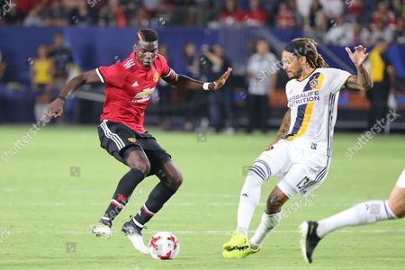 Manchester United midfielder Paul Pogba (6) tries to juke past Los Angeles Galaxy midfielder Jermaine Jones (13) in the game between the Manchester United vs LA Galaxy, Club Team Friendly, StubHub Center, Carson, CA. USA. Photographer: Peter Joneleit/Cal Sport Media