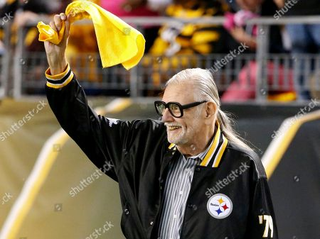 """Stock Image of George A. Romero Horror film director George Romero, who directed """"The Night of The Living Dead"""" waves a Terrible Towel before an NFL football game between the Pittsburgh Steelers and the Baltimore Ravens in Pittsburgh. It was the anniversary of the film that was made in the Pittsburgh area. Romero, whose classic """"Night of the Living Dead"""" and other horror films turned zombie movies into social commentaries and who saw his flesh-devouring undead spawn countless imitators, remakes and homages, has died. He was 77. Romero died, following a battle with lung cancer, said his family in a statement provided by his manager Chris Roe"""