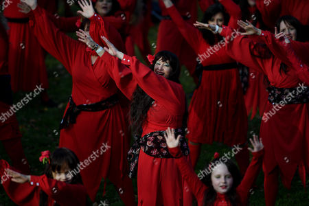 Kate Bush fans dressed in red dance during The Most Wuthering Heights Day Ever flash mob in Melbourne, Victoria, Australia, 15 July 2017 (issued 17 July 2017). Fans gathered to recreate British singer Kate Bush's 1978 Wuthering Heights music video.