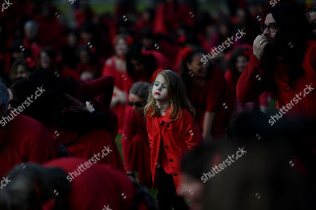 Hundreds of Kate Bush fans dressed in red dance during The Most Wuthering Heights Day Ever flash mob in Melbourne, Victoria, Australia, 15 July 2017 (issued 17 July 2017). Fans gathered to recreate British singer Kate Bush's 1978 Wuthering Heights music video.