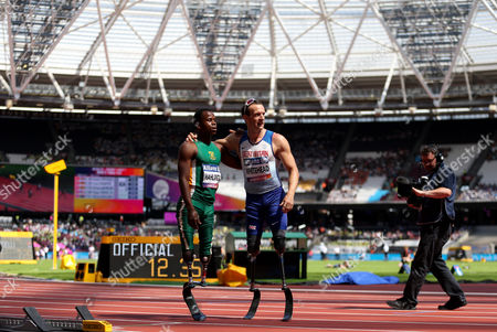 Great Britain's Richard Whitehead with South Africa Ntando Mahlangu after falling during the Men's 100m T42 heat