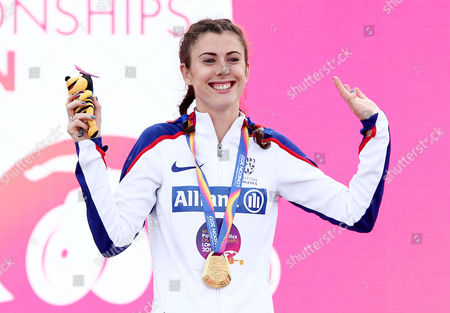 Stock Image of Olivia Breen of Great Britain celebrates after receiving her gold for winning the Womens Long Jump T38.