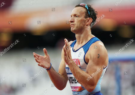 Richard Whitehead of Great Britain applauds the crowd  after finishing third in the Mens 100m T42.
