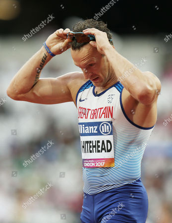 Richard Whitehead of Great Britain looks dejected after finishing third in the Mens 100m T42.